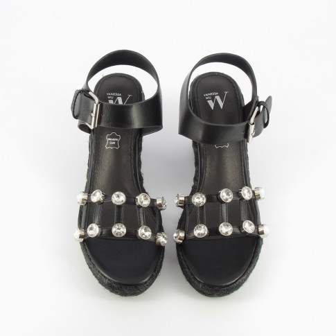 Black wedge sandals adorned with costume jewels