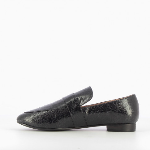 Black loafers with crackled effect and silver buckle