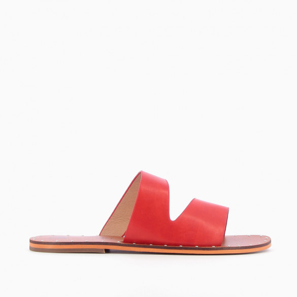 Red asymmetrical mules