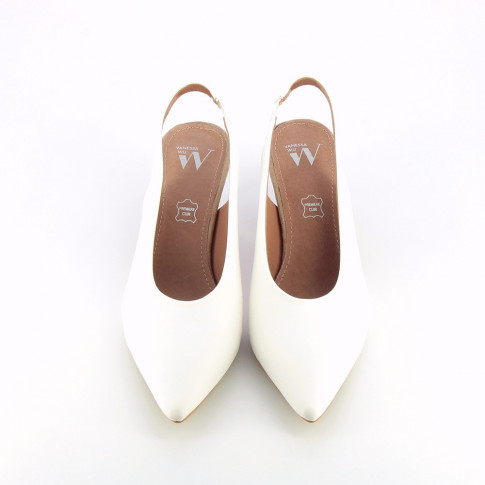 White faux leather sling back pumps