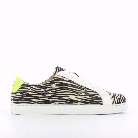 Zebra-print sneakers with neon yellow laces