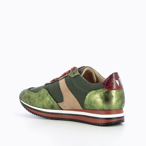 Green sneakers with striped sole