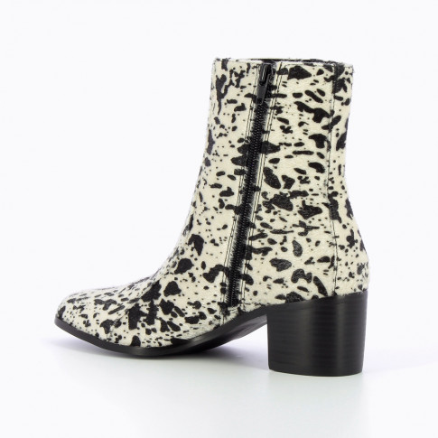 White cow-print ankle boots with heel