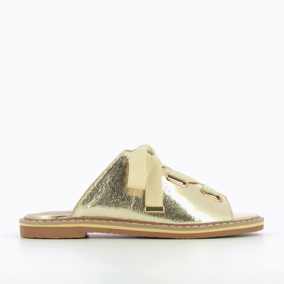 Gold mules with grosgrain ribbon