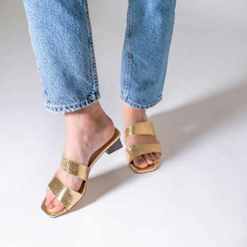 Gold snakeskin mules with trapezium heel