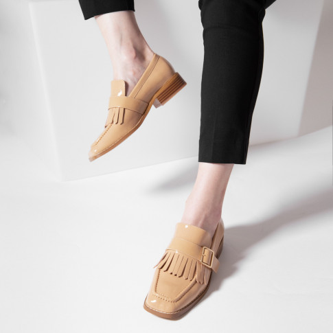 Nude patent fringed loafers