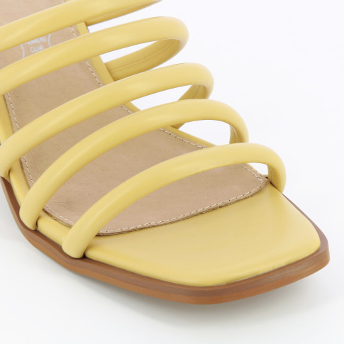 Pastel yellow mules with ball heel