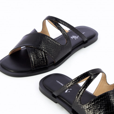 Black flat mules with crossed straps