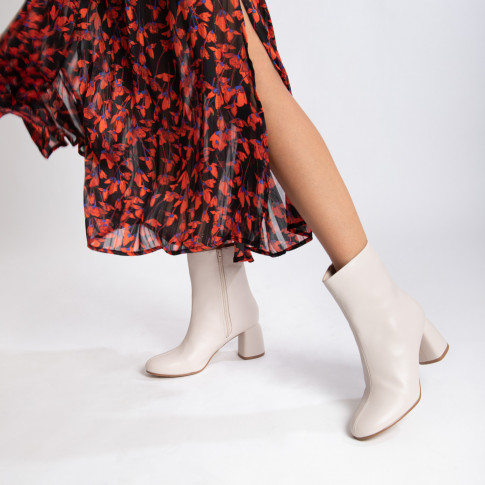 Light beige ankle boots with curved heel
